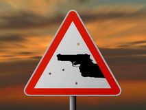 Warning: criminality!. Triangle sign with handgun and bullets holes, sunset Royalty Free Stock Photos
