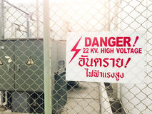 Warning danger high voltage sign and thai language mean danger h Royalty Free Stock Image