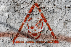 Warning danger sign on the wall close up Royalty Free Stock Image