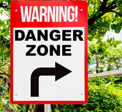 Warning Danger Zone red signage. In forest Royalty Free Stock Photo