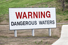 Warning Dangerous Waters Sign. A big sign near a hydroelectric dam in Tennessee warns boaters, swimmers and others of the dangerous waters below Stock Photos