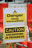 Warning deep excavation beyond this hoarding, don't cross, danger deep excavation. PERAK, MALAYSIA – SEPTEMBER 17, 2015: Warning deep excavation beyond Royalty Free Stock Photo