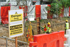 Warning deep excavation beyond this hoarding, don't cross, danger deep excavation. PERAK, MALAYSIA – SEPTEMBER 17, 2015: Warning deep excavation beyond Royalty Free Stock Images