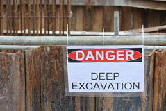 Warning deep excavation beyond this hoarding, don't cross, danger deep excavation. PERAK, MALAYSIA – SEPTEMBER 17, 2015: Warning deep excavation beyond Stock Images