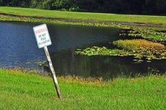 Warning Do Not Feed Alligator sign. Royalty Free Stock Photo