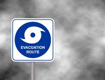 Warning evacuation route road. Hurricane season with symbol sign against a stormy grey sky background. Vector illustration. Warning evacuation route road vector illustration