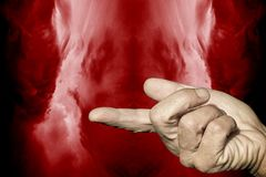 Warning finger. On the background of the red flames Royalty Free Stock Photos