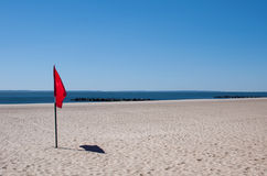 Warning flag on a beach Stock Image