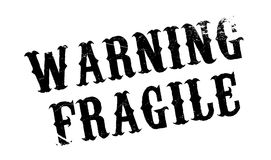 Warning Fragile rubber stamp Royalty Free Stock Photography
