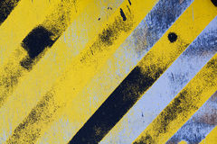 Warning hazard background. Textured hazard background with Black and yellow angled lines Royalty Free Stock Images