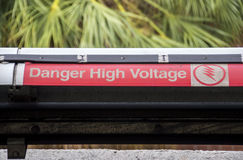 Warning on high voltage on railway tracks Stock Photos