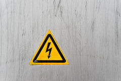 Warning high voltage sign on the dashboard Royalty Free Stock Image
