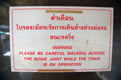 Warning information plate at Thailand railway station Royalty Free Stock Photo