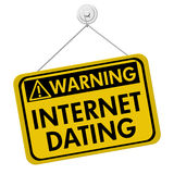 Warning about Internet Dating. A yellow and black sign with the words Internet Dating isolated on a white background, Warning about Internet Dating Royalty Free Stock Photo