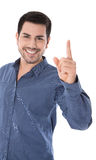 Warning: isolated smiling man pointing with his forefinger. Isolated man on white with a blue shirt pointing with his forefinger stock photo