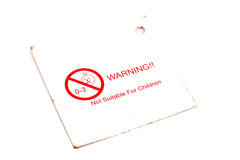 Warning label. White warning label over white background stock photo