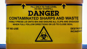 Warning label on a sharps bin Royalty Free Stock Image