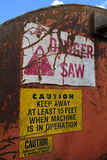 Warning Labels on Log Cutoff Slasher Saw. Warning stickers on log slasher saw stock photo