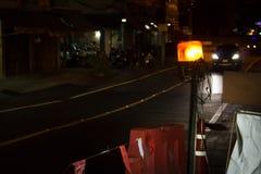 Warning light alert on the road at night. Stock Photo