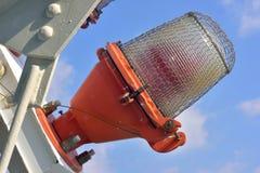 Warning light. Red flashing warning light against blue sky Royalty Free Stock Photo