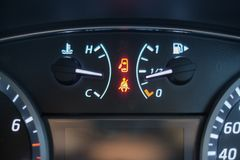 Warning light  sign of seat belt and door. Open on car dashboard Stock Photography