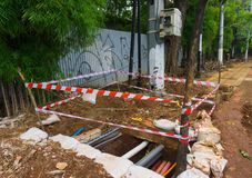 Warning line surrounding a hole photo taken in Jakarta Indonesia Stock Images