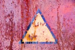 Warning mark. On rusty iron Stock Photo