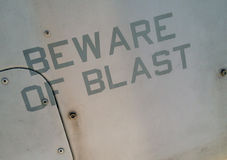 Warning message on military aircraft. Warning of jet engine blast on military aircraft Stock Images