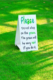 Warning message signage on the grass Stock Images