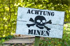 Warning of mines. Danger of explosion. Line of defense. Military base. German inscription: Royalty Free Stock Images