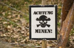 Warning mines. Warning sign with German text Watch out mines Stock Photos