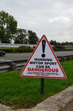 Warning motor sport can be dangerous sign. Royalty Free Stock Image