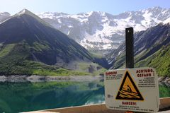Warning near artificial Lac de Grand-Maison, Rhone-Alpes, France royalty free stock images