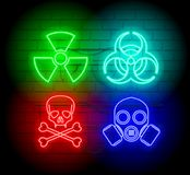Warning neon silhouette of biohazard icons. Neon style sign illustration. Brickwall as background Stock Image