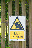 Warning notice dangerous bull. A warning notice at Levisham in Yorkshire to warn walkers that the field they are entering has a bull in it with consequent danger stock image