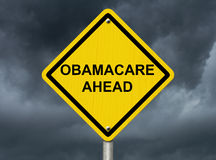 Warning about Obamacare. An warning sign against a stormy sky with words Obamacare Ahead, Warning about Obamacare Royalty Free Stock Image