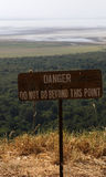 Warning plate on the hill above lake manyara Royalty Free Stock Image