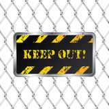 Warning plate with wired fence Royalty Free Stock Photography