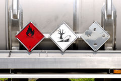 Warning plates on liquid container Royalty Free Stock Images