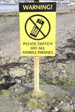Warning please switch off all mobile phones yellow black sign stock images