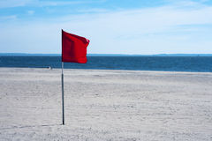 Warning red flag at the beach Royalty Free Stock Image