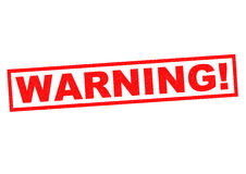 WARNING!. Red Rubber Stamp over a white background Stock Photos