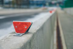 Warning reflectors on the barrier stock image
