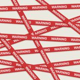 Warning ribbons over gray background Stock Photo