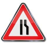 Warning road narrowing. And small street Royalty Free Stock Photos