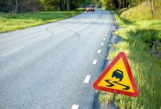 Warning road sign. European warning sign for slippery road Royalty Free Stock Photography