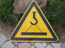 Warning road sign crane. Standing outdoor Royalty Free Stock Image