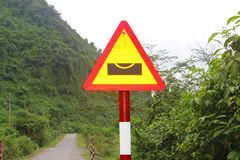 Warning road sign floods, Phong Nha, Vietnam royalty free stock photo