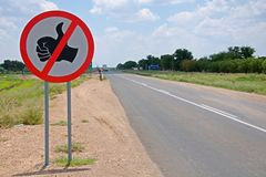 Warning of road sign - hitchhiking is not allowed Royalty Free Stock Photography