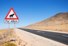 Warning of road sign - hyenas on the road Royalty Free Stock Images